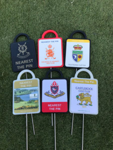Assorted golf markers for Irish clubs