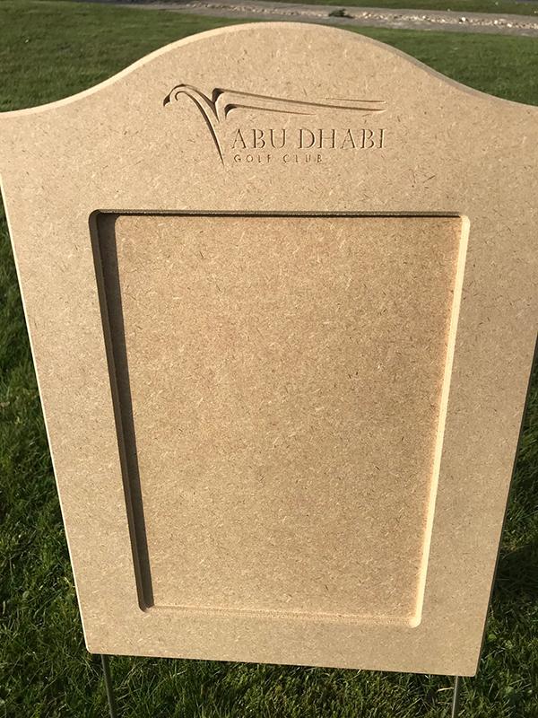 Laser cut artwork for branding on wooden golf markers